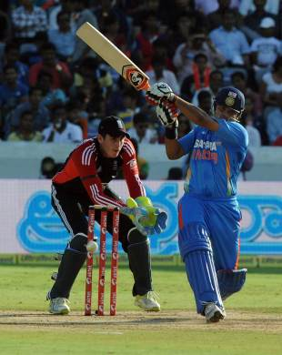 Suresh Raina tries to cut loose on a tricky pitch, India v England, 1st ODI, Hyderabad, October 14, 2011