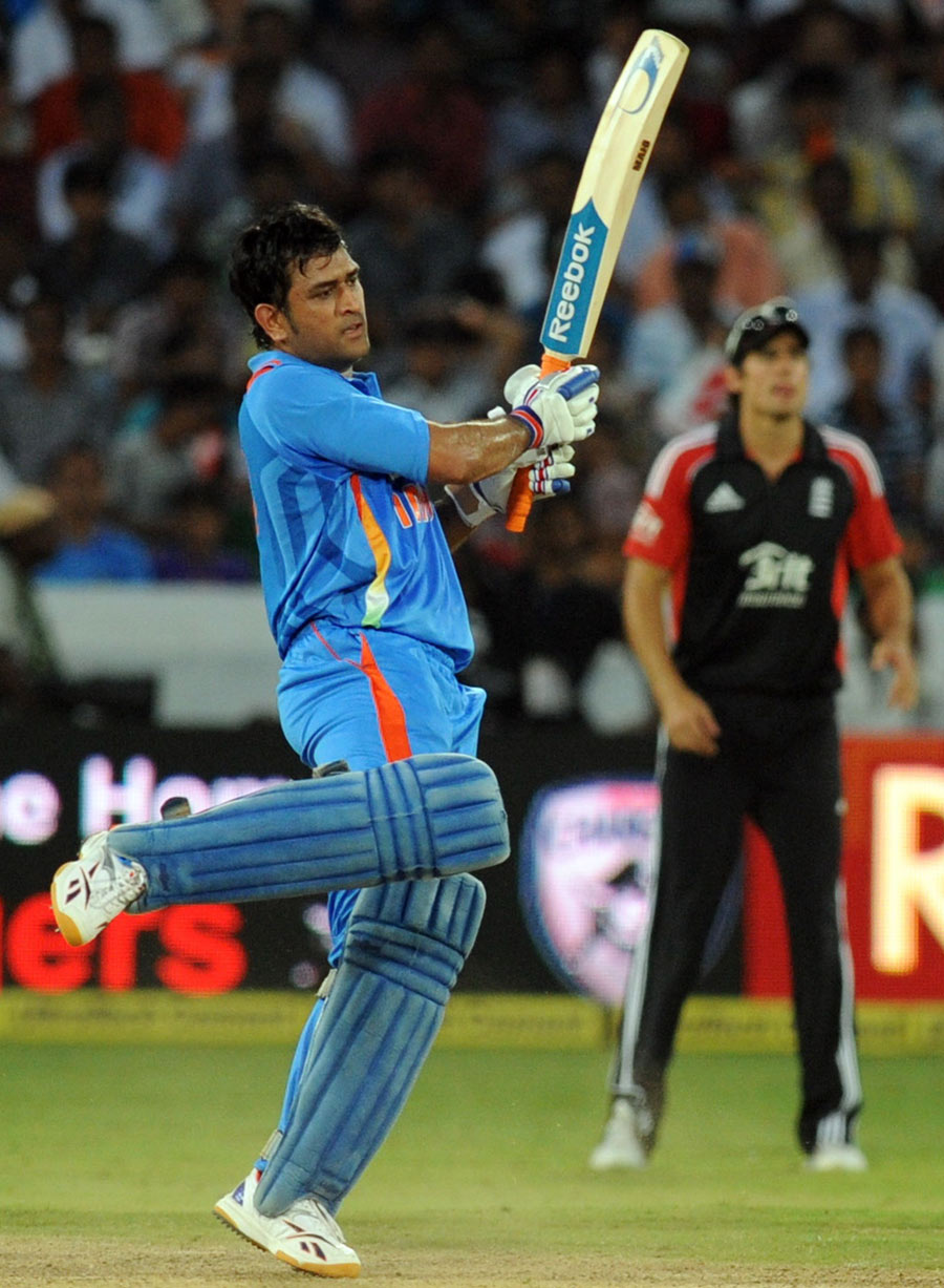 A unique follow-through from MS Dhoni | Cricket Photo ... Mahendra Singh Dhoni Helicopter Shot Video