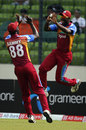 Darren Sammy and Andre Russell celebrate a wicket