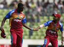 Kemar Roach and Devendra Bishoo get together after a wicket