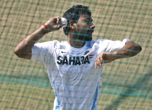 Praveen Kumar bowls during a training session, New Delhi, October 16, 2011