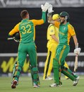 Rusty Theron and Wayne Parnell high-five after their matchwinning stand, South Africa v Australia, 2nd Twenty20, Johannesburg, October 16 2011