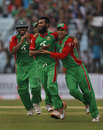 Suhrawadi Shuvo celebrates a wicket with his team-mates