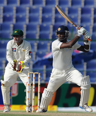 Angelo Mathews forces a shot through the covers, Pakistan v Sri Lanka, 1st Test, Abu Dhabi, 1st day, October 18, 2011