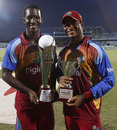 Player-of-the-Series Marlon Samuels with Darren Sammy and the winners' trophy