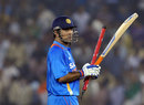 MS Dhoni marches off after a job well done, India v England, 3rd ODI, Mohali, October 20, 2011