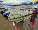 The ground staff pull the covers off, Bangladesh v West Indies, 1st Test, Chittagong, 2nd day, October 22, 2011