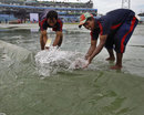 The covers are full of water in Chittagong, Bangladesh v West Indies, 1st Test, Chittagong, 2nd day, October 22, 2011