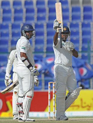 Prasanna Jayawardene celebrates his hundred as Kumar Sangakkara looks on, Pakistan v Sri Lanka, 1st Test, Abu Dhabi, 5th day, October 22, 2011