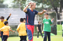 Hong Kong's Sixes player Peter Wooden enjoys a cricket clinic with a group of underprivileged boys from the South Asian community on 22nd OCtober 2011 as part of the build-up to the KARP Group Hong Kong Cricket Sixes at Kowloon Cricket Club