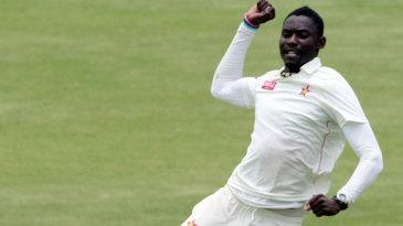 Chris Mpofu celebrates a wicket
