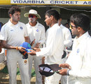Sreesanth hands Sanju Samson his cap on his first-class debut, Vidarbha v Kerala, Ranji Trophy Plate League 2011-12, Nagpur, 1st day, November 3, 2011