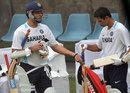 Rahul Dravid inspects Yuvraj Singh's bat, Delhi, November 4, 2011