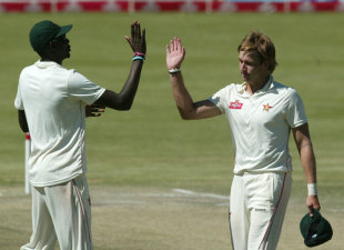 Kyle Jarvis high-fives Chris Mpofu after completing his maiden five-for, Zimbabwe v New Zealand, only Test, Bulawayo, 4th day, November 4, 2011