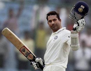Sachin Tendulkar raises his helmet after reaching 15,000 Test runs, India v West Indies, 1st Test, New Delhi, 3rd day, November 8, 2011