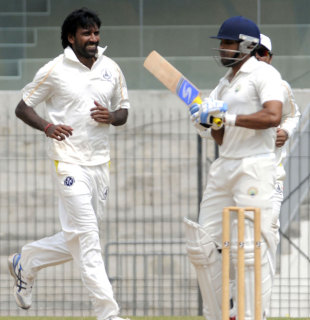L Balaji celebrates one of his three wickets