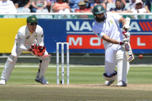 Hashim Amla comes down the track to play one to the leg side, South Africa v Australia, 1st Test, Cape Town, 3rd day, November 11, 2011