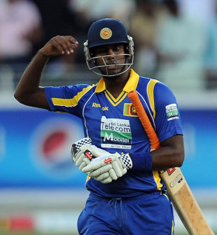 Angelo Mathews walks back after being caught short of the crease, Pakistan v Sri Lanka, 1st ODI, Dubai, November 11, 2011