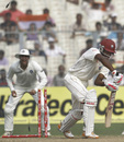 Darren Bravo is bowled by Umesh Yadav