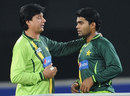Mohsin Khan has a word with Umar Akmal