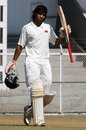 Abhishek Nayar acknowledges applause for his century
