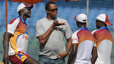 Courtney Walsh talks to members of the West Indian team
