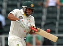 Usman Khawaja pulls during his half-century