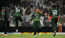 Saeed Ajmal is congratulated on dismissing Angelo Mathews, Pakistan v Sri Lanka, 4th ODI, Sharjah, November 20, 2011