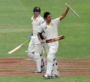 Pat Cummins and Mitchell Johnson walk off after Australia's successful chase, South Africa v Australia, 2nd Test, Johannesburg, 5th day, November 21, 2011