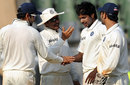 Varun Aaron celebrates his dismissal of Darren Sammy