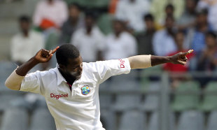 Darren Sammy celebrates MS Dhoni's wicket, India v West Indies, 3rd Test, Mumbai, 4th day, November 25, 2011