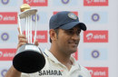 MS Dhoni receives the winners' trophy, India v West Indies, 3rd Test, Mumbai, 5th day, November 26, 2011