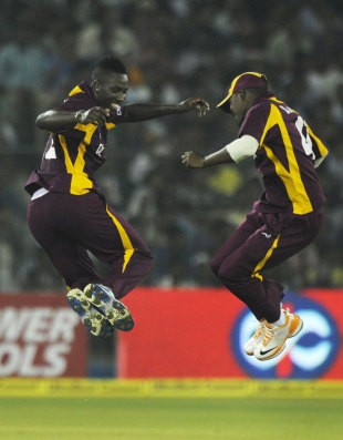 Andre Russell and Darren Bravo celebrate a wicket, India v West Indies, 1st ODI, Cuttack, November 29, 2011