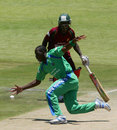 Shingi Masakadza fields the ball off his own bowling