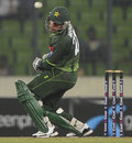 Misbah-ul-Haq weaves out of the way of a short ball