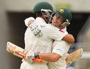 Usman Khawaja and David Warner embrace after hitting the winning runs