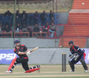 Jamie Atkinson lofts the ball to the boundary against Nepal