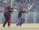 Nepal's Gyanendra Malla cuts the ball for four against Hong Kong during the ACC Twenty20 Cup 2011 match at Tribhuvan University Ground in Kathmandu on 3rd December 2011