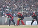 Nepal's Anil Mandal is bowled by Moner Ahmed during the ACC Twenty20 Cup 2011 match in front of a big crowd at Tribhuvan University Ground in Kathmandu on 3rd December 2011