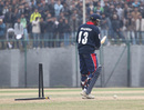 Nepal's Pradeep Airee has his stumps destroyed by Hong Kong's Irfan Ahmed at the ACC Twenty20 Cup 2011 in Kathmandu