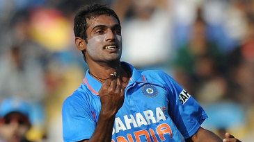Abhimanyu Mithun pumps his fist after dismissing Danza Hyatt
