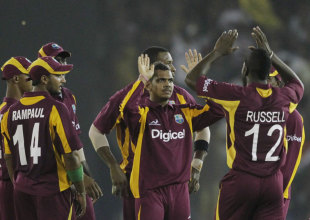 Sunil Narine is congratulated on his first international wicket, India v West Indies, 3rd ODI, Ahmedabad, December 5, 2011