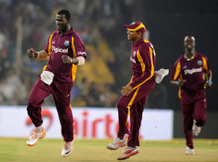Darren Sammy is pumped up after effecting Rohit Sharma's run out, India v West Indies, 3rd ODI, Ahmedabad, December 5, 2011