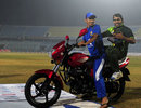 Nasir Hossain gives Umar Akmal a ride on the bike he won as Bangladesh's best player of the series, Bangladesh v Pakistan, 3rd ODI, Chittagong, December 6, 2011