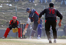 Kuwait's Mohammed Asghar hits out against Moner Ahmed at the ACC Twenty20 Cup 2011 at the Tribhuvan University Cricket Ground in Kathmandu