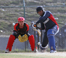 Kuwait's Adnan Idrees winds up to hit another big shot against Hong Kong at the ACC Twenty20 Cup 2011 in Kathmandu on 7th December 2011