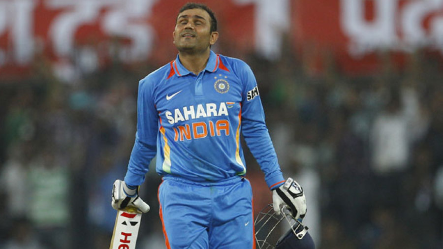 Virender Sehwag reacts after getting to a double-ton