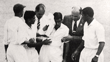 Nari Contractor is helped off the field after being struck by Charlie Griffith © The Cricketer