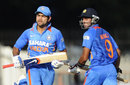 Virat Kohli and Manoj Tiwary run between the wickets