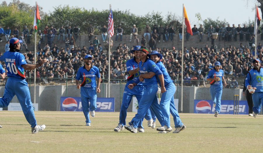 Afghanistan celebrate a wicket during their victory in the ACC T20 final